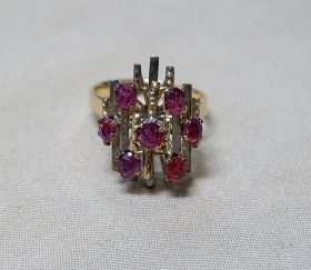 220G. Gold and Ruby Ring    $246