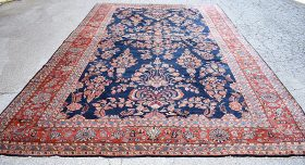 251A. Blue Sarouk Room-size Carpet, 16ft 4in x 10ft 6in    $2,337