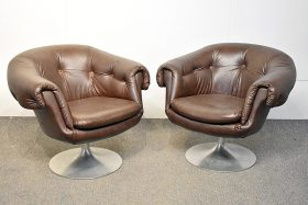278. Pair of Overman Brown Swivel Club Chairs    $215.25