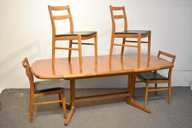 287. Danish Teak Extension Table and Four Chairs    $590